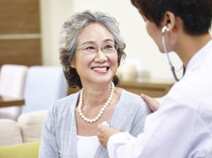 65510160 - family doctor checking smiling senior asian woman using stethoscope