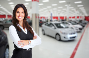 47710075 - car dealer woman. auto dealership and rental concept background.