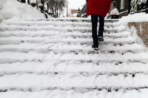 51309699 - woman climbs the stairs in the snow